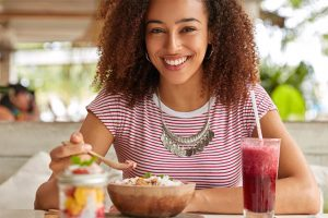 The woman eats healthy food.