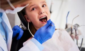 The dentist explains the three classes of malocclusion.