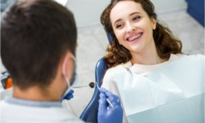 The dentist will adjust the dental braces of the patient.